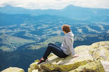 Woman sitting stone