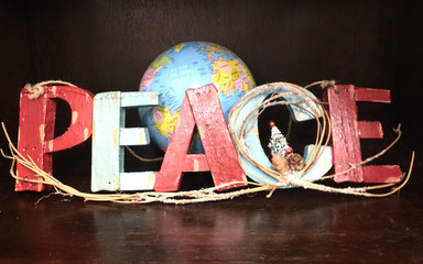 peace wood text with christmas tree and earth globe