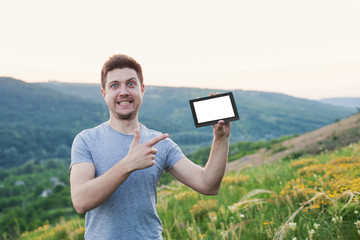 Men hold an eBook with a white screen in his hand and smile