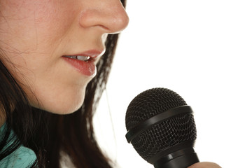 Young woman with microphone.