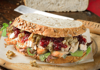 Chicken, turkey sandwich with stuffing and cranberry sauce. Christmas leftovers.