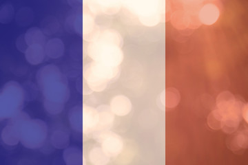 French flag on bokeh background, pray for Paris