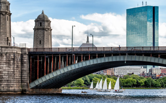 Boston historic Longfellow Bridge framing a view of sailboats on the Charles River