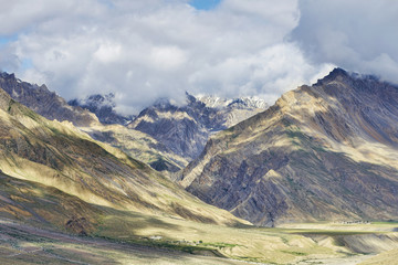 Remote river valley among majestic high mountains