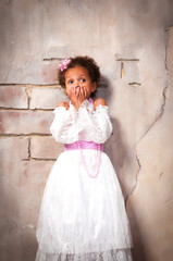 Little actress. Beautiful african  girl shows emotions: fear, fright, surprise