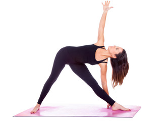 Beautiful woman doing Parivrtta Trikonasana  pose