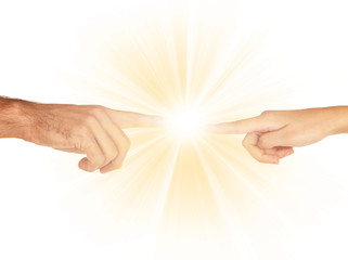 Fototapete - Women and men hand attracted to each other with light isolated on white