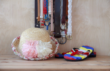Set of clothes and various accessories for women on old wooden t