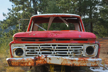 Rusting Red and White Pickup Truck