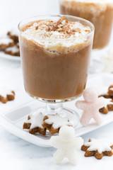 festive pumpkin latte and almond biscuits, vertical closeup