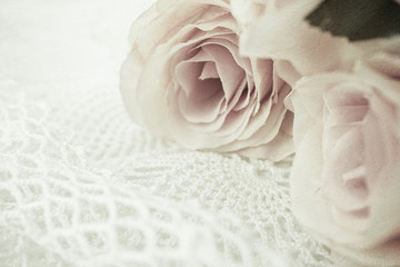 roses flowers in vintage color style on mulberry paper texture for romantic background