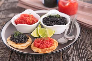 Foto auf Acrylglas Vorspeise canape, caviar and blini