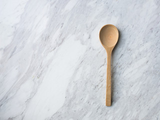 Wooden Spoon on white marble.