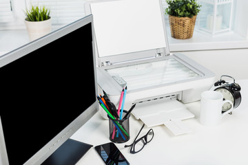 Working place of a business person. Computer, printer and other office supplies