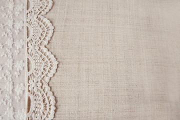 Lace on linen copy space background, vintage tone