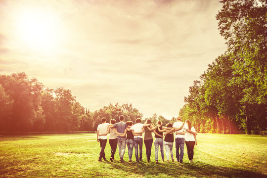 Group of Teenage Friends in the Park at Sunset