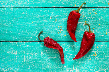 Red peppers on a wooden background (space for text)