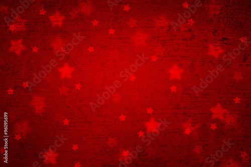 grunge magical blurry star shape abstract christmas and new year holidays copy space on red background