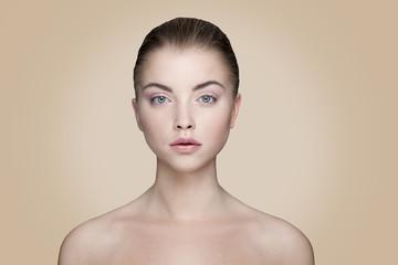 beautiful woman on cream background