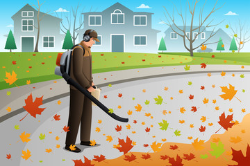 Man Clean Up Leaves During Fall Season Using a Blower