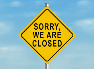 Sorry, we are closed. Road sign on the sky background. Raster illustration.