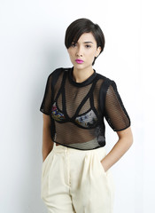 Fashion girl model posing on white background in the studio.