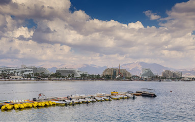 Eilat is a famous resort Israeli city with beautiful beaches, resort hotels and numerous spots of water sport, entertainments and shopping