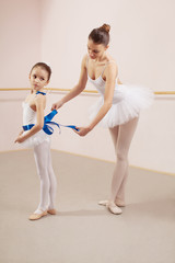 Prepariing for ballet class in dance studio