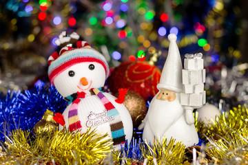 Christmas decoration, Snowman, Santa, balls, tinsel on blurred lights background