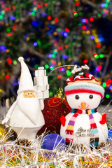 Christmas decoration, Snowman, Santa, balls, tinsel on blurred lights background