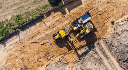 aerial view of excavator working on the field