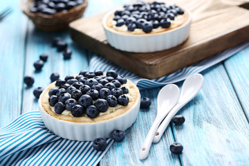 Homemade blueberry tart on blue wooden table