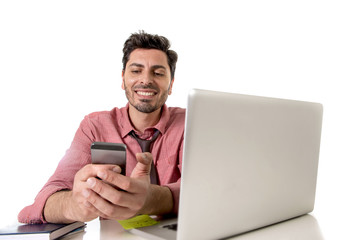 businessman working at office desk texting with mobile phone in