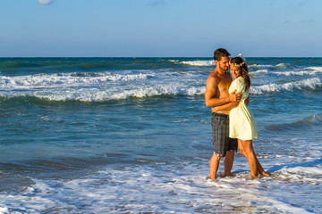 Attractive young couple in beachwear at the beach.