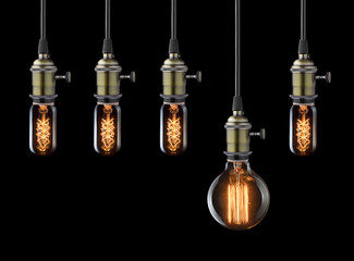 Idea concept. Vintage light bulbs on black