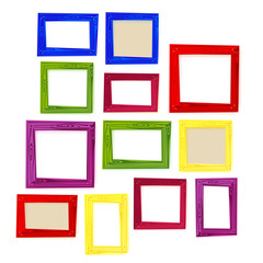 Set of color wooden frames on white background.