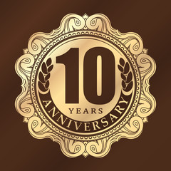 Vintage anniversary 10 years round emblem. Retro styled vector b
