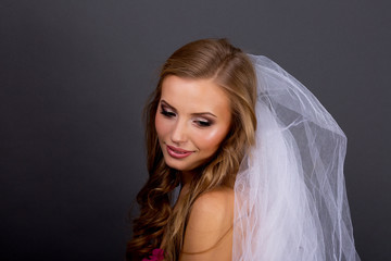 Close-up face of beautiful caucasian brunet woman. Studio shot