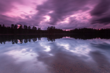 Twilight scene over a calm lake, dalarna, sweden