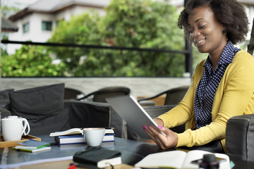 African Woman Using Tablet Relaxation Concept