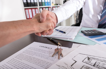 Estate agent shaking hand with his customer