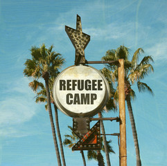 aged and worn vintage photo of refugee camp sign with palm trees