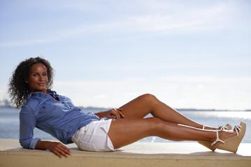 Woman posing on a ledge