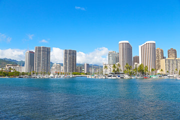 Honolulu in an early morning, Hawaii. Yachts and buildings near the water in Honolulu, Hawaii..