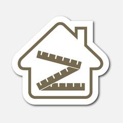 Logo maison et mètre.