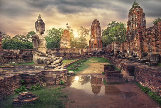 ancient Buddha statue and old Wat Mahathat pagoda in history temple of  Ayutthaya Historical Park,world heritage sites of unesco.Vintage effect add for create atmosphere