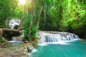 Deep forest waterfall at Huay Mae Kamin waterfall National Park Wall mural
