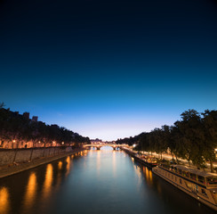 Louvre at night time, a view from a bridge