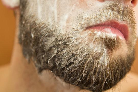 Closeup of beard man with soap on face
