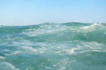 clean turquoise sea wave close up, soft focus